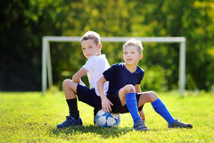 Two little brothers having fun playing a soccer game Stock Photo