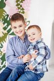 Two little brothers hugging and laughing. Children. The concept. Of family, childhood and education stock photography
