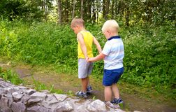 Two little brothers play outdoors.  Stock Image