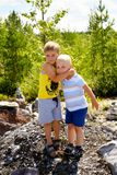 Two little brothers play outdoors.  Stock Photos
