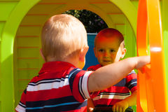 Two little brothers in playhouse Royalty Free Stock Image