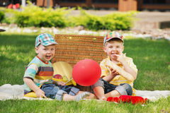 Two little brothers playing on the balnket Stock Photo