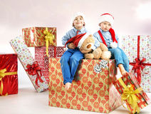 Two little brothers among presents Royalty Free Stock Photo