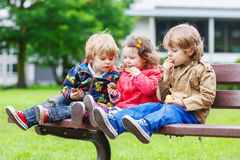 Two little brothers and sister having fun in park. Stock Images