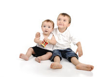Two little brothers sitting Stock Photo