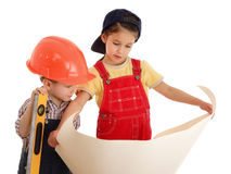 Two little builders with blueprints Stock Image