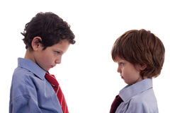 Two little businessmen confronted, face to face. Isolated on white background Royalty Free Stock Photography