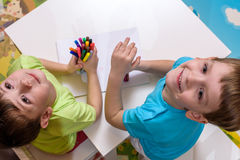 Two little caucasian friends playing with lots of colorful plastic blocks indoor. Active kid boys, siblings having fun building an. Two little caucasian friends Royalty Free Stock Photography