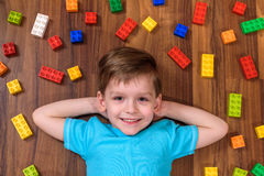 Two little caucasian friends playing with lots of colorful plastic blocks indoor. Active kid boys, siblings having fun building an. Two little caucasian friends Royalty Free Stock Image