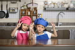 Two little chef show victory sign Stock Photography