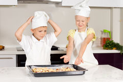 Two Little Chefs Bake Food for Lunch Stock Image