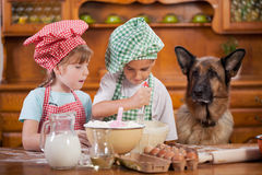 Two little chefs enjoying in the kitchen making big mess. German Royalty Free Stock Photo