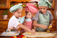 Two little chefs enjoying in the kitchen making big mess Royalty Free Stock Image