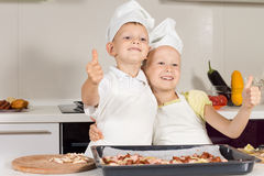 Two Little Chefs Showing Thumbs Up Royalty Free Stock Images