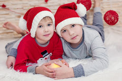 Two little child santa embracing Royalty Free Stock Photography