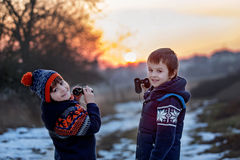 Two little children, boys, exploring nature with binoculars Royalty Free Stock Photo