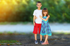 Two little children brother and sister together. Girl in dress h Royalty Free Stock Photos