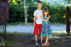 Two little children brother and sister together. Girl in dress h. Ugging boy. Family relations concept Royalty Free Stock Photography