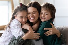 Free Two Little Children Hug Young Caucasian Mother Stock Image - 217011521