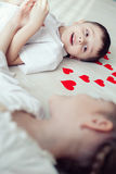 Two little children lying on the floor. Stock Photos