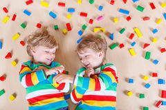 Two little children playing with colorful wooden Royalty Free Stock Photo