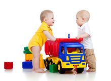 Free Two Little Children Playing With Color Toys Royalty Free Stock Photo - 23363005