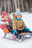 Two little children sit in sledge Stock Photography