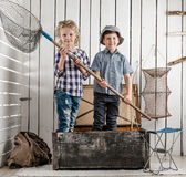 Two little children standing in chest with net in hands Royalty Free Stock Photo