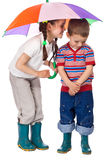 Two little children under umbrella Royalty Free Stock Photography