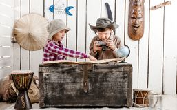 Free Two Little Children Watching Map Royalty Free Stock Images - 118956049