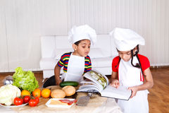 Two little cooks Stock Photography
