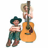 Two Little Cowboys With a Guitar. Pre-teen and a pre-schooler with cowboy hats , boots and a guitar, isolated against a white background stock photography