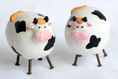 Two little cows. Decorative cows Royalty Free Stock Images