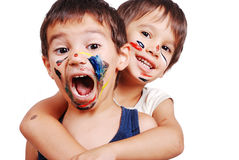 Two little cute brothers with colors on their face royalty free stock photos