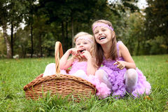 Two little cute girlfriend in beautiful dresses are laughing in the sum Royalty Free Stock Photo