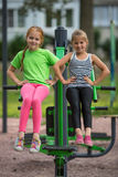 Two little cute girls is engaged in fitness equipment Royalty Free Stock Photo