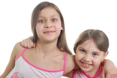 Two little cute girls(friends). Isolated over white background Stock Photos