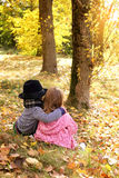 Two little cute kids dating with hand lifts onto shoulder in autmn pa Royalty Free Stock Images
