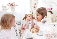 Two little cute sisters playing Royalty Free Stock Photography