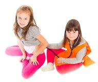 Two Little Cuties Playing Seriously Royalty Free Stock Images