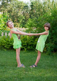 Two little dancing girl Royalty Free Stock Image