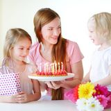 Two little daughters and mom with birthday cake Royalty Free Stock Images