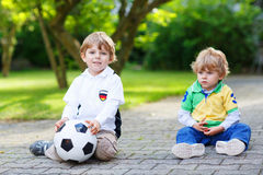 Two little fan boys at public viewing of football game Royalty Free Stock Photo