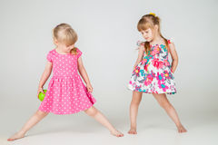 Two Little fashion girls in beautiful dress Royalty Free Stock Photo