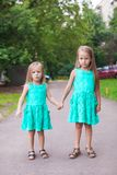 Two little fashion sister walking together on Royalty Free Stock Photos