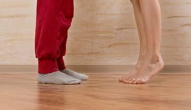 Two Little Feet on Wooden Floor Stock Images