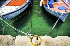 Two Little Floating Boats Tied-Up stock photos