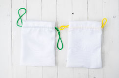 Two little gift bags with colorful ties Stock Images