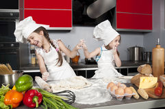 Two little girl cook Stock Photo