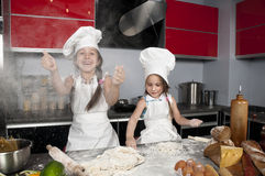 Two little girl cook Royalty Free Stock Photos